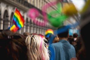 Rear View Of People Walking In Gay Pride Parade