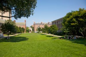 Students relaxing on grass on campus of Brown University, Providence, Rhode Island